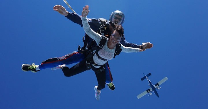 Kim skydiving