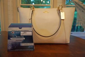 A White Smile and an Ava Coach Bag Enter to Win Professional grade 3D White  Strip Kit and an Ava Coach Bag from Kristo Orthodontics! Giveaway Value    455! ea94dd6fc4666